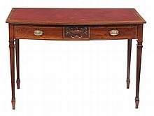 A mahogany bowfront writing table in George III style
