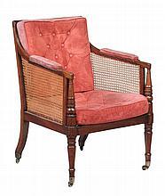A Regency bergere library chair , circa 1815