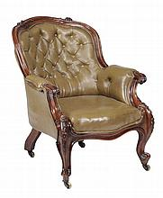 A victorian leather upholstered library chair , circa 1870