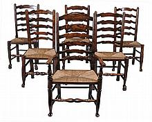 A set of 12 ladder back dining chairs , 19th century, to include one carver