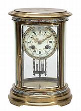 A French champleve enamelled brass oval four glass mantel clock