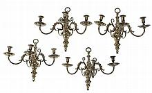 A set of four gilt brass three light wall appliques in late 17th/ early 18th...