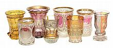 Eight various Bohemian colour-flashed and engraved beakers
