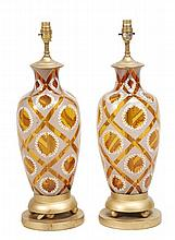 A pair of amber and painted glass table lamps, in