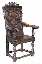 An oak panel back armchair, circa 1660 and later,
