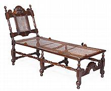 A walnut and caned daybed, late 17th century, the