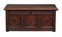 An oak coffer, 17th century, the hinged