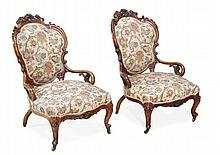 A pair of Victorian walnut and upholstered low