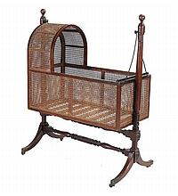 A Regency mahogany cradle on stand, circa 1800