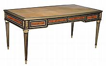 A French ebony, kingwood and gilt metal mounted writing table