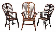 A yew, ash and elm high back Windsor armchair , second quarter 19th century
