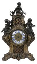 A French bronze and gilt metal mantel clock in Louis XIV style