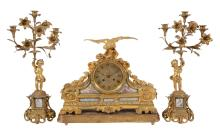 A French ormolu and sevres style porcelain plaque mounted mantel clock