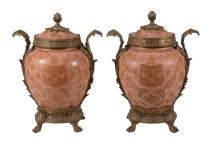 A pair of Oriental pale-pink-ground and metal mounted urns and covers in the...