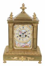A French gilt-metal and Sevres-style porcelain mantel clock in neo-classical...