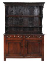 An oak dresser , 18th century, with canopy plate rack superstructure