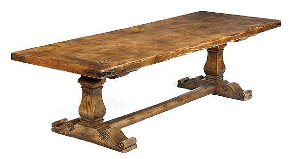 A stained hardwood trestle table , 20th century,