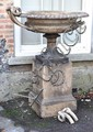 A Victorian stoneware twin handled garden urn on