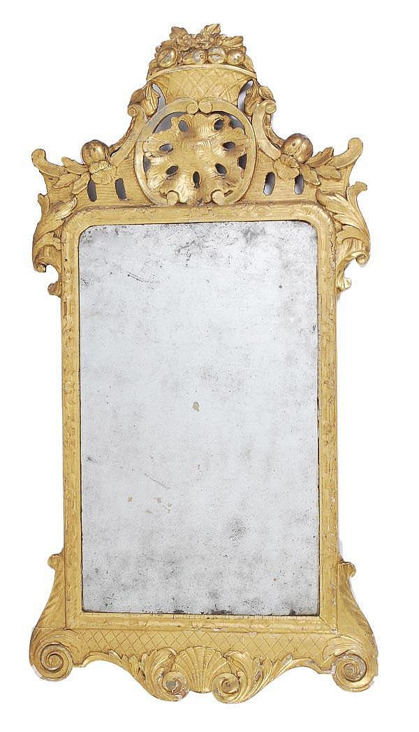 A George II giltwood and gesso mirror, circa 1745,