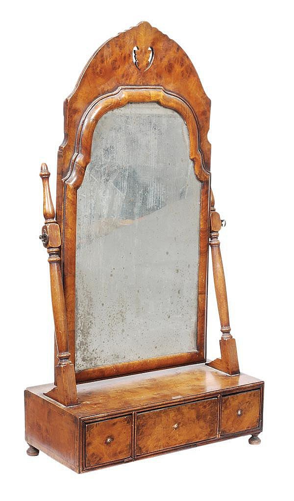 A burr walnut dressing mirror in 18th century