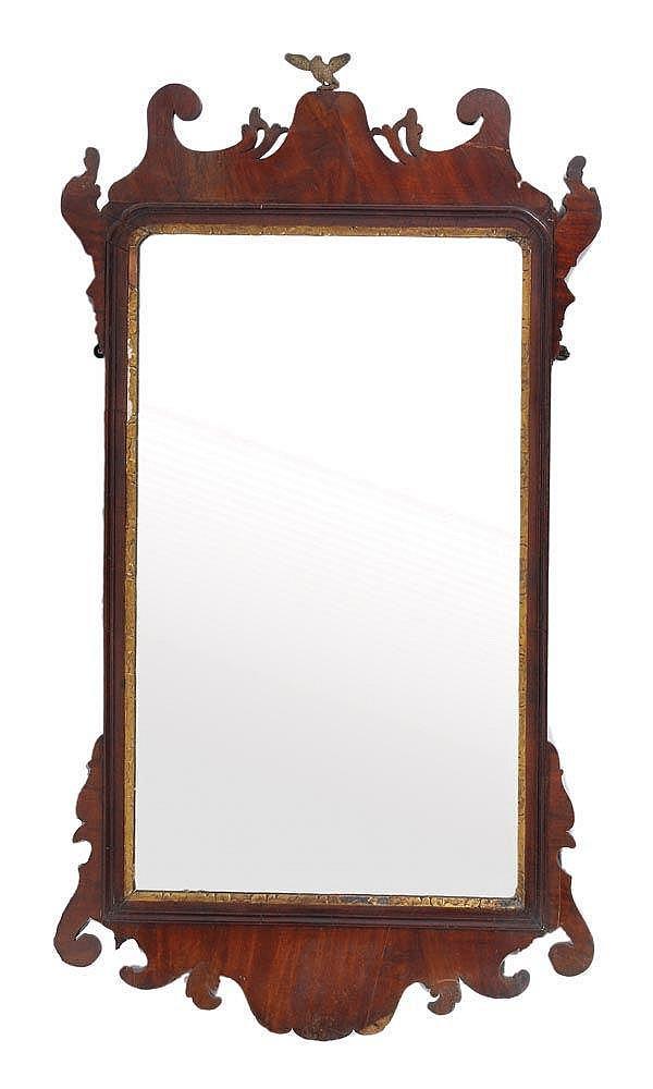 A George II mahogany and parcel-gilt mirror, circa