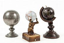 China.- - A pewter terrestrial globe tea caddy,