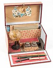 A travelling writing case with portable globe,