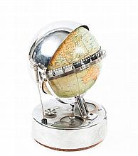 A mid 20th century German chromed metal-mounted electric globe timepiece