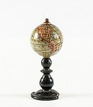A miniature pocket 1 inch terrestrial globe,