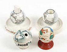 An English pottery ink well with two liners, modeled as a globe, 11cm in height