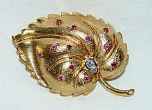 14kt  Custom leaf broach with  12 rubies & 2 diamonds 18.4 grams,  measures 2.25