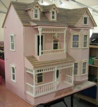 Three storey dolls house and contents