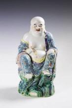 A SIGNED CHINESE FAMILLE ROSE PORCELAIN BUDDHA