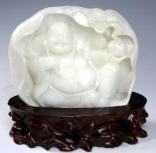 A CHINESE WHITE JADE LUOHAN