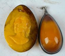 2 Chinese Butterscotch Amber Pendants