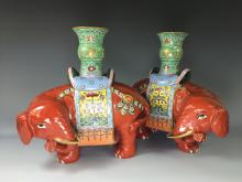 PAIR OF CORAL-RED ELEPHANT PORCELAIN CANDLE HOLDERS