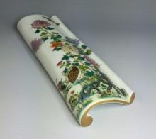 A CHINESE FAMILLE ROSE PORCELAIN ARM REST