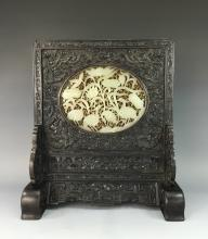 A FINE CARVED WHITE JADE AND ZITAN TABLE SCREEN; 19TH C