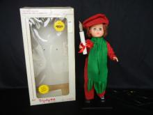 The Best Selling Animated and Illuminated  Moving Figurines  by Displayed Arts  Doll Green Scarf