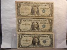 Three 1957 One Dollar Silver Certificates