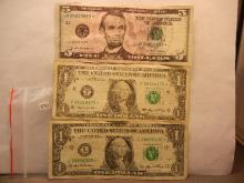One 2009 Five Dollar Star Note & Two 2006 One Dollar Star Notes