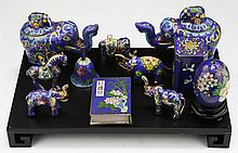 Eleven (11) Chinese Cloisonne On Bronze Items On Stand