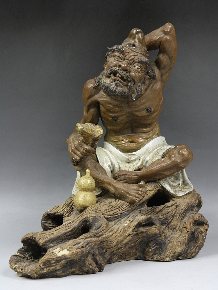 An Antique Chinese Carved Porcelain Statue
