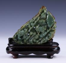 A Fine Chinese Jade Carved Dragon Group