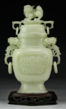 A Chinese Carved Serpentine Jade Vase With Cover