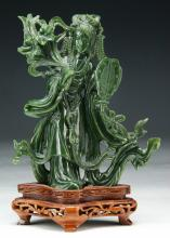 A Chinese Carved Spinach Jade Beauty