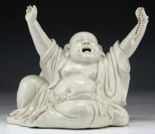 A Chinese White Glazed Porcelain Buddha