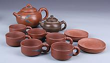 Fourteen Chinese Yixing Tea Sets