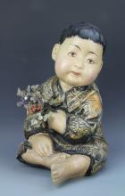 Chinese Pottery Figure of a Boy