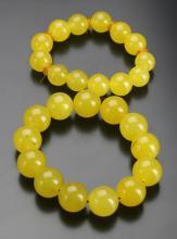 Two Chinese Yellow Jade Bracelets